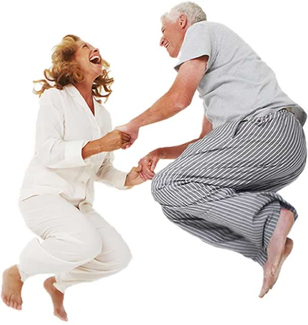 Couple Jumping on Bed